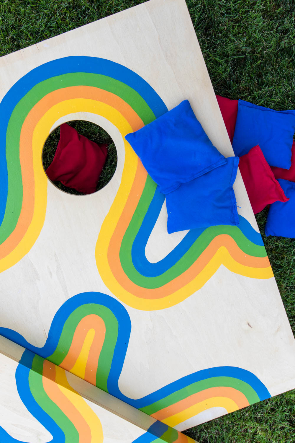 cornhole makeover in grass with beanbags