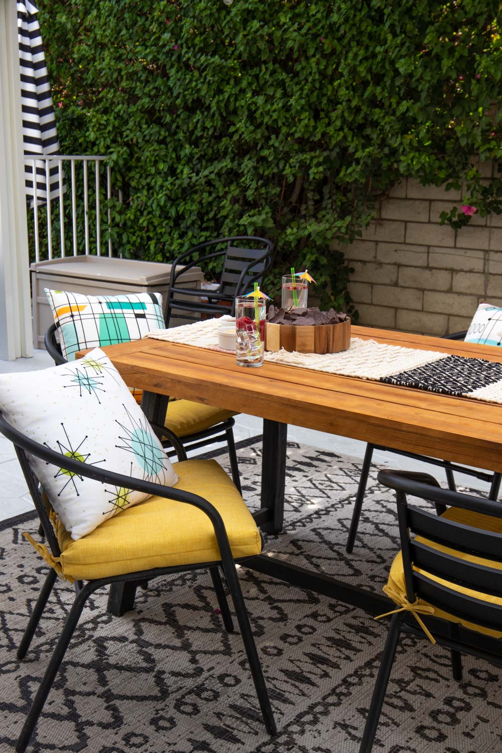 backyard oasis with table, chairs and decor from wayfair
