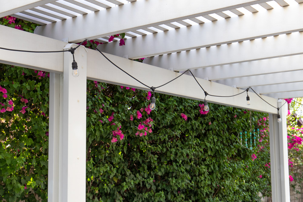 market lights hanging from pergola