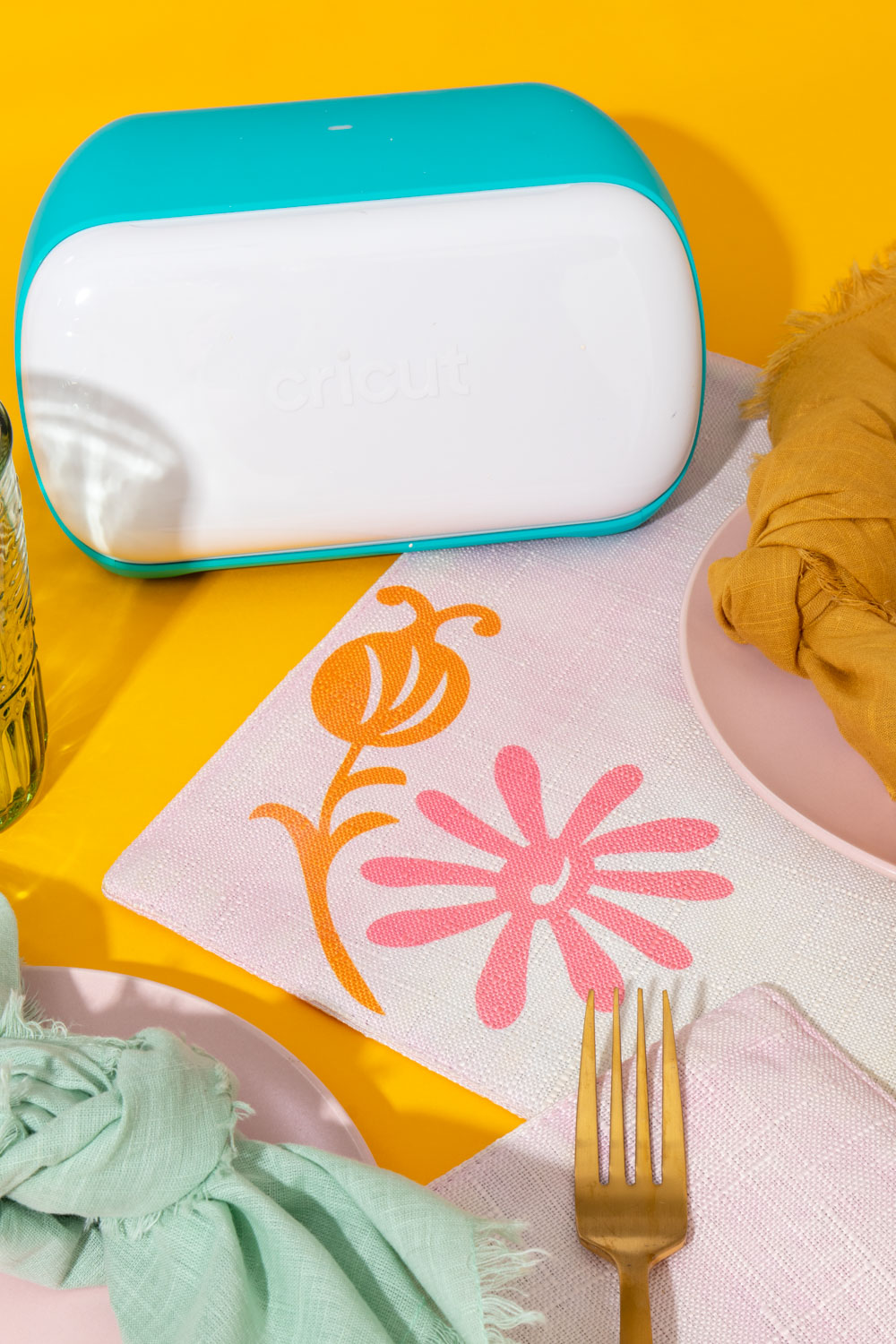 Cricut Joy next to modern placemats with floral pattern